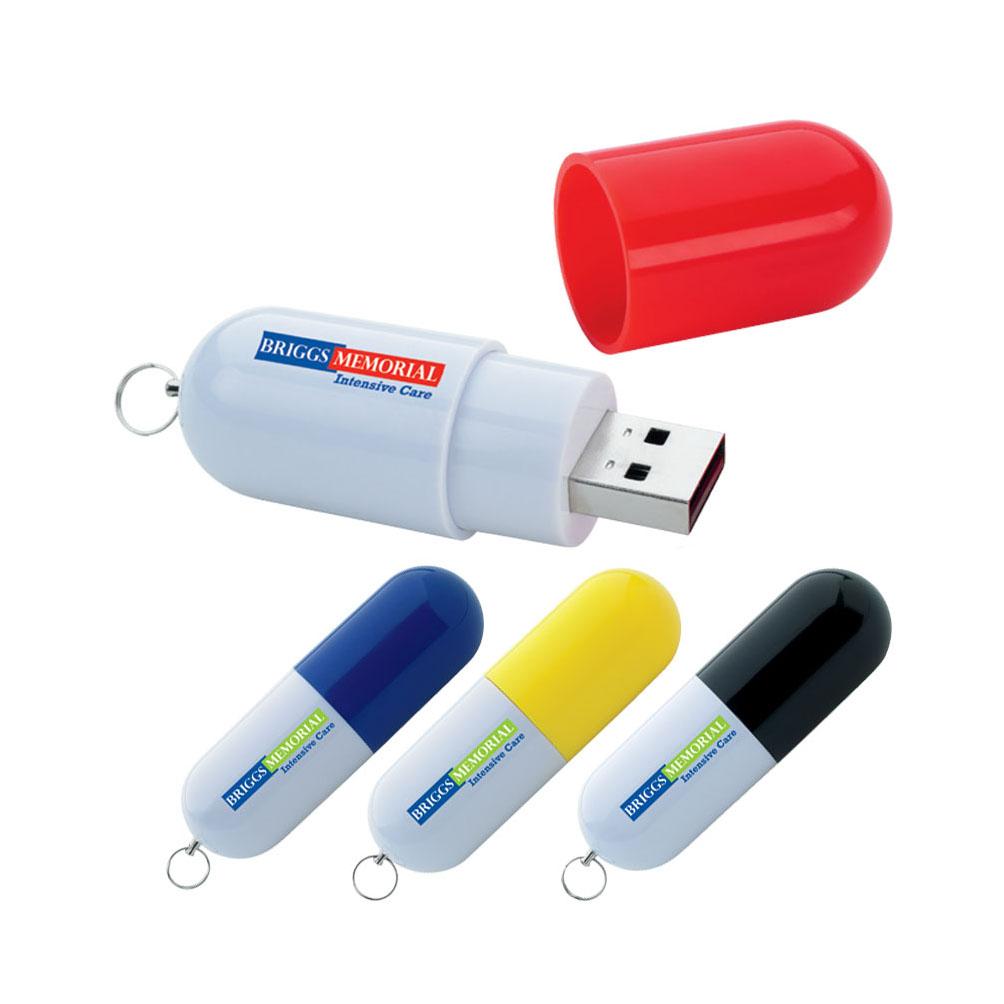 Memoria USB en forma de capsula de Plastico con tapa y anillo metalico.